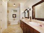 Master bathroom with granite shower, double vanities, soaking tub and walk-in closet