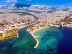 Town Omiš with amazing scenery,huge sandy beach and Dalmatian pearl-Cetina river