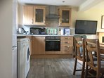 Open plan kitchen/dining/living area.