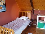 SECOND BEDROOM (3 SINGLE BEDS)
