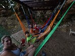 Guest enjoying our hammocks on our small cove beach