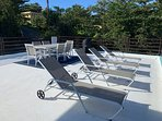 Shared rooftop patio loungers