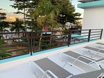 Shared rooftop patio lounger view