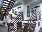Entrances and stairs to the second floor lofts. Murals designate each room's entrance!