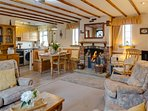 Open plan lounge/diner with cosy open fire.