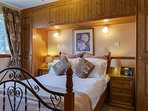 Double bedroom looking out to open countryside. Luxurious Sealy mattress.