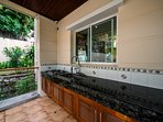 Thai-style kitchen outside.