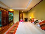 Poolside bedroom has double aspect views of pool and Chalong Bay.
