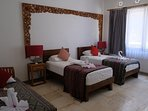New, third bedroom with two single beds (King Koil mattresses) and third sofa bed.