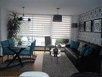 Área social y de comedor del apartamento, un lugar ideal para descansar y compartir.