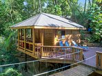 Turtle Cabin Private Deck. Fully equipped Stainless Kitchen and Custom Bathroom.  Outside Shower