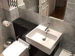 Carrara marble bathroom with modern fittings
