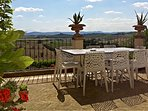 Panoramic terrace equipped for 'Al Fresco' dining with a view