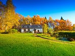 Fern Cottage on a bright autumn day.