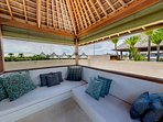 Rooftop lounge with views of the surf and sunset