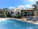 Back of Villa Tyche, private garden with outstanding sea views