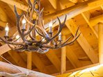 Large Antlers Chandelier brightens the cabin
