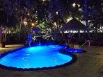 Heated pool and tiki torches at night