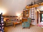 Living Room, Television, Barn-Style Loft, Sofa, High-back Chair, Entrance Hallway w/ Master Bedroom