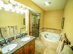28-Basement Master Bathroom with Walk-in Travertine shower, Jacuzzi Bath & 2 Sinks.