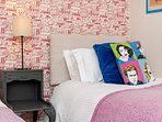 Bedroom 3 - our favourite wallpaper and more funky fun cushions