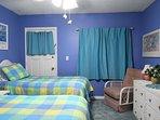 2nd bedroom with en-suite bathroom; swivel-rocker; new (2019) curtains and artwork.
