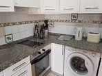 Fully equipped kitchen with oven, microwave, washing machine, etc