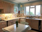 Fully equipped kitchen with sea views