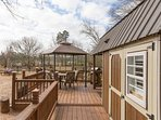 Tiny House deck with gas grill overlooking the paddocks