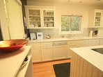 Kitchen with dishwasher, refrigerator, stove/oven & microwave