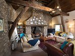 Relax on the large comfy sofas in the spacious and impressive lounge with log fire and wooden beams.