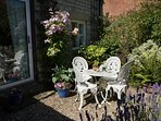 Patio garden table and chairs amongst the lavender and clematis.  Extra seating available.