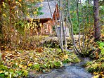 Creek burbling by the cabin powers the microhydro