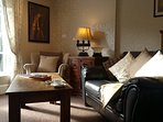 Relax in the cosy beautifully decorated lounge. Enjoy the view of the Iron Bridge and river