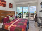 Guest bedroom with 1 queen bed, TV and ocean view