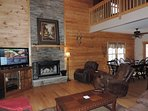 Living Room Has a Wood burning Fireplace and Flat Screen TV