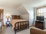 Upper level bedroom with two twins and a full bed