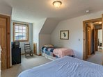 Upper level bedroom with queen and twin bed