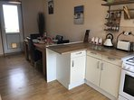 Kitchen / Diner Complete with Oven, Microwave, Fridge Freezer, Griddle and Coffee Maker