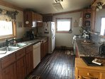 Enter into the galley kitchen, full equip, with everything, ice maker too