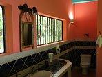 Elegantly tiled en suite bathroom with in wall hairdryer