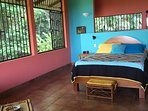 Delightful jungle views surround first en suite bedroom with queen-sized bed