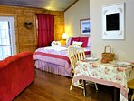 The Woodcreek Cabin was designed with romance in mind. Chocolates, plush robes, hot tub, fireplace!