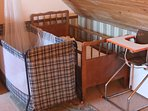 Two cots / cribs for young children, and high chair