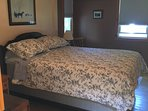Master bedroom - queen bed with black out shades