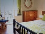 Spacious bedroom wth King size bed and French door to Balcon overlooking gardens.