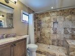 The en-suite bathroom features a luxurious walk-in shower.