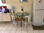 Full size fridge.  Table with chairs. Fan