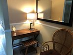 Cozy place to use for make-up table or writing desk.  In master bedroom.