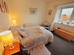 Double Bedroom 1 with south facing garden view over the Cheviot Hills